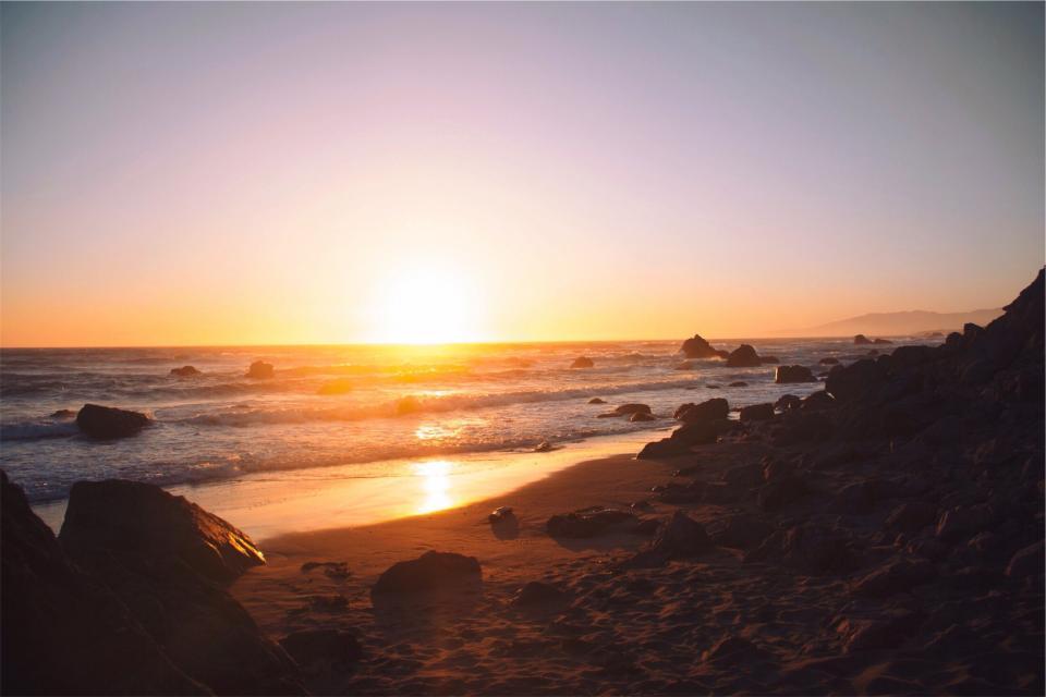 sunset, beach, sand, shore, water, waves, ocean, sea, horizon, sky, rocks, boulders