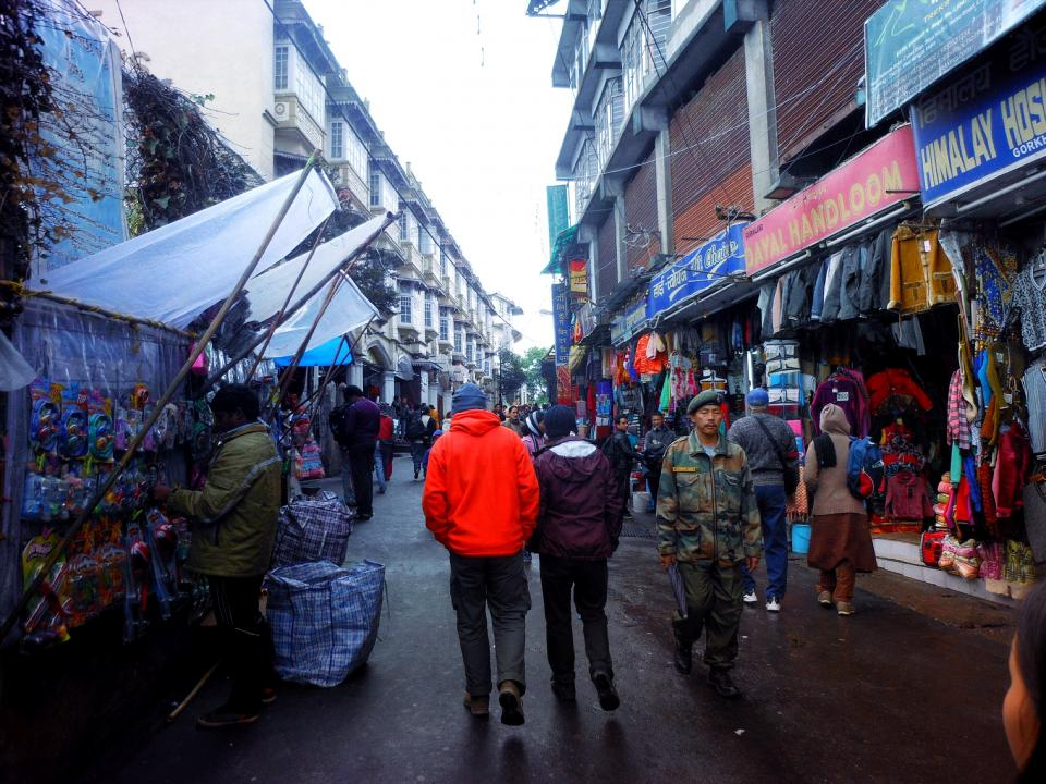streets, market, buying, selling, shops, stores, pedestrians, people, army, uniform, buildings