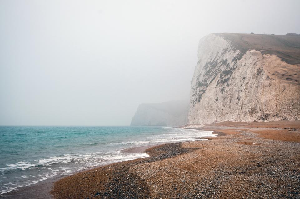 grey, sky, mountains, hills, cliffs, beach, sand, ocean, water, waves, shores, rocks, pebbles, sea