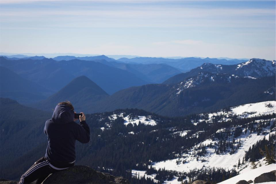 photographer, picture, camera, young, guy, kid, hoodie, mountains, peaks, valleys, snow, landscape, sky, trees