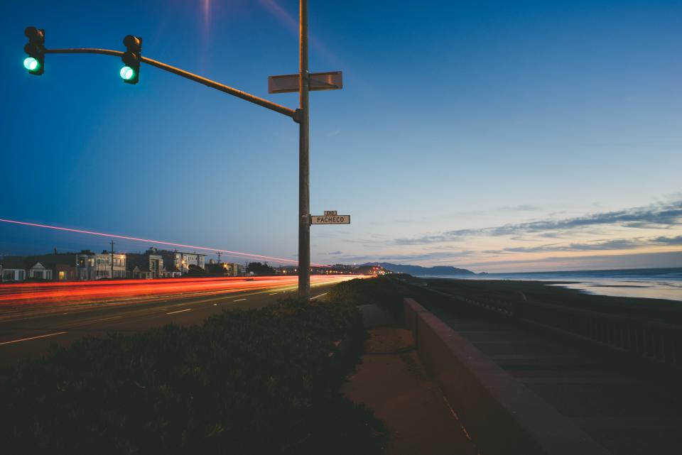 street, road, coast, ocean, sea, night, evening, traffic lights, sign, sidewalk, dusk, sky, city