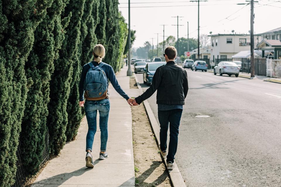couple, love, romance, holding hands, girl, woman, guy, man, people, walking, pedestrians, sidewalk, street, road, pavement, cars, city, urban, neighborhood, neighbourhood, sunshine