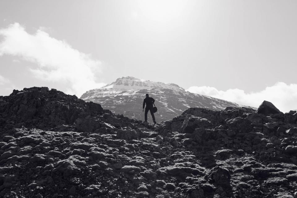 mountains, rocks, guy, man, people, peaks, cliffs, sky, black and white, adventure, hiking