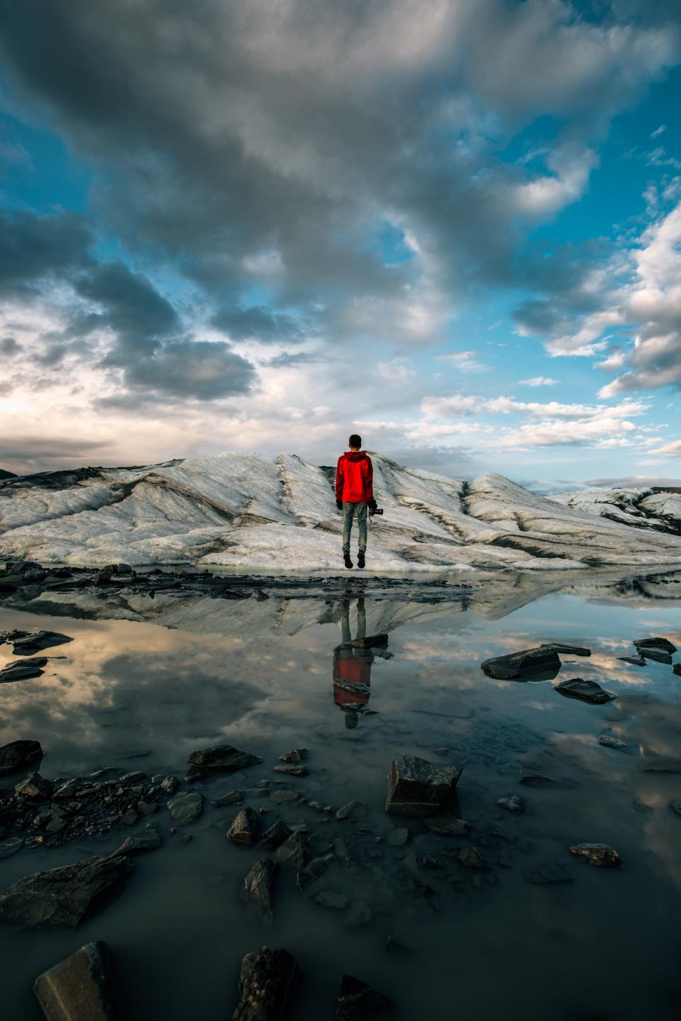 guy, man, male, people, back, contemplate, stand, nature, landscape, rocks, slabs, water, lake, puddle, reflection, sky, clouds, horizon, travel, trek, photography