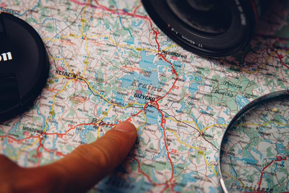 map, finger, pointing, directions, canon, camera, lens, magnifying glass
