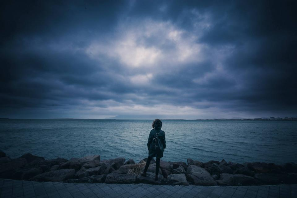 storm, clouds, dark, lake, water, rocks, people, coat, backpack, evening, sky