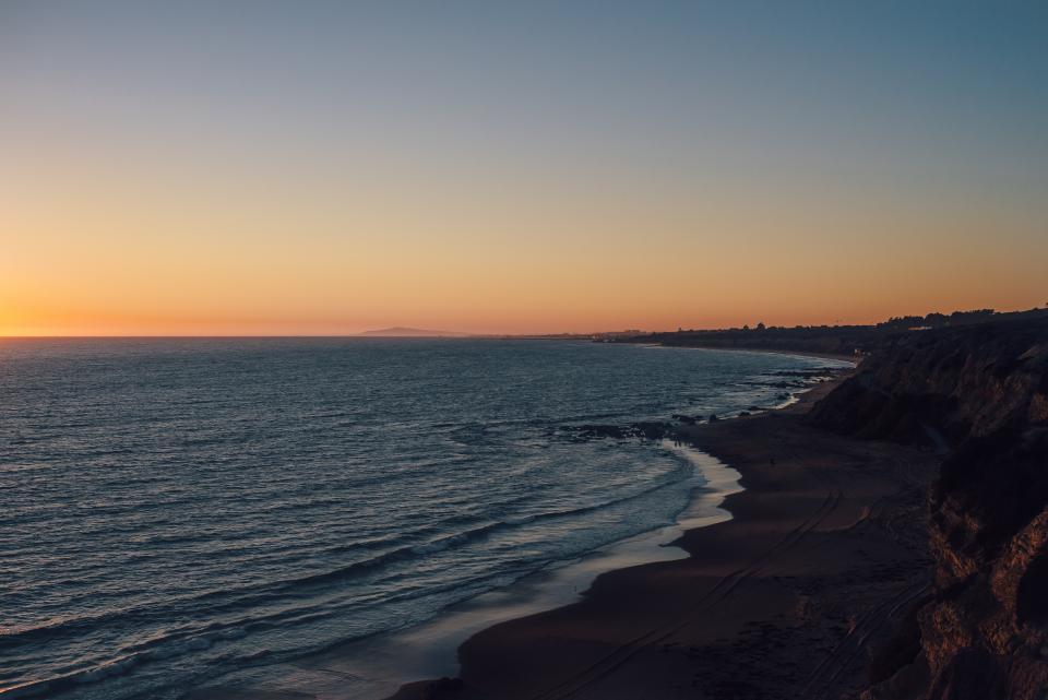 beach, sand, sunset, dusk, sky, ocean, sea, shore, water, coast, landscape, nature, outdoors, travel, vacation, trip