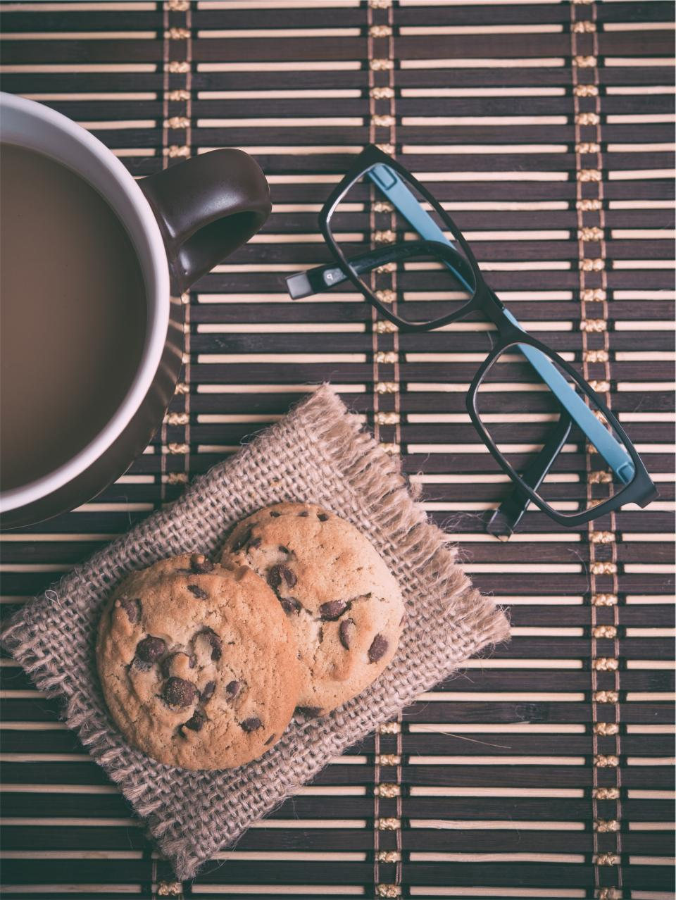 coffee, chocolate chip, cookies, eyeglasses, cup, mug, snack, food, dessert
