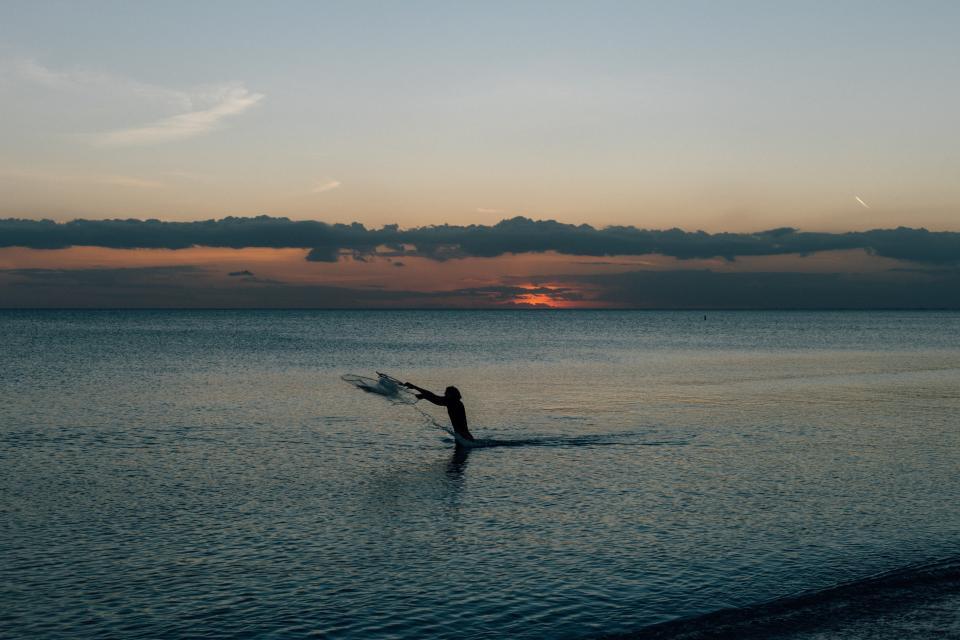 nature, water, ocean, sea, sky, clouds, horizon, sunset, sunrise, dusk, dawn, sun, light, man, guy, people, splash, ripples, silhouette, shadow, blue