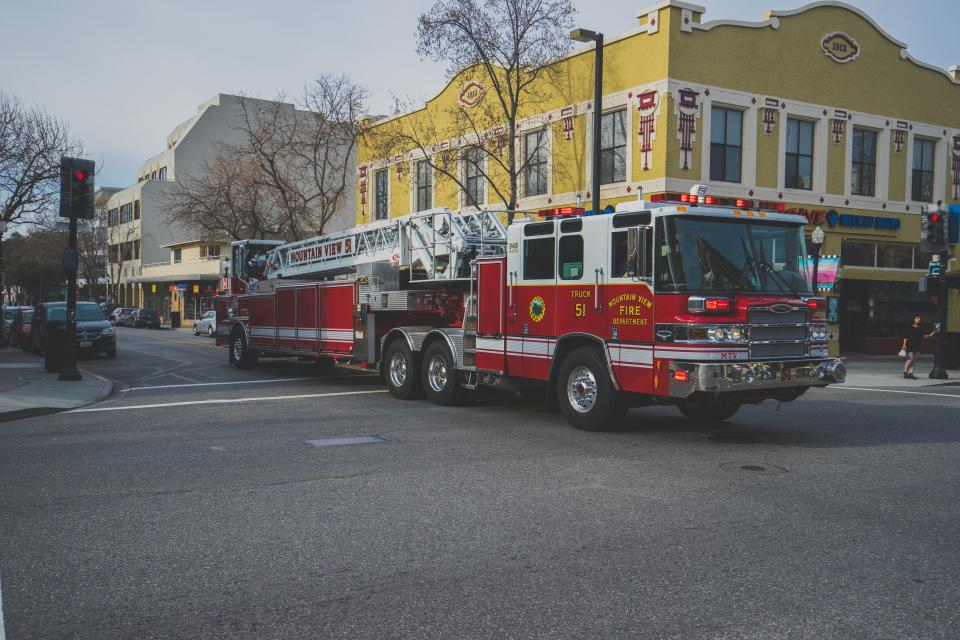 red, fire truck, emergency, intersection, street, road, city