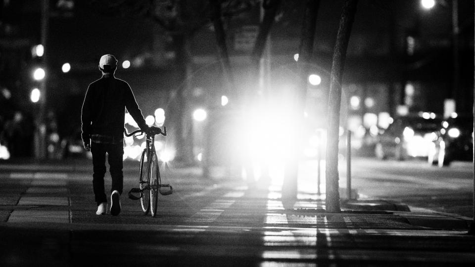 city, streets, bike, bicycle, guy, man, people, intersection, lights, black and white, lifestyle