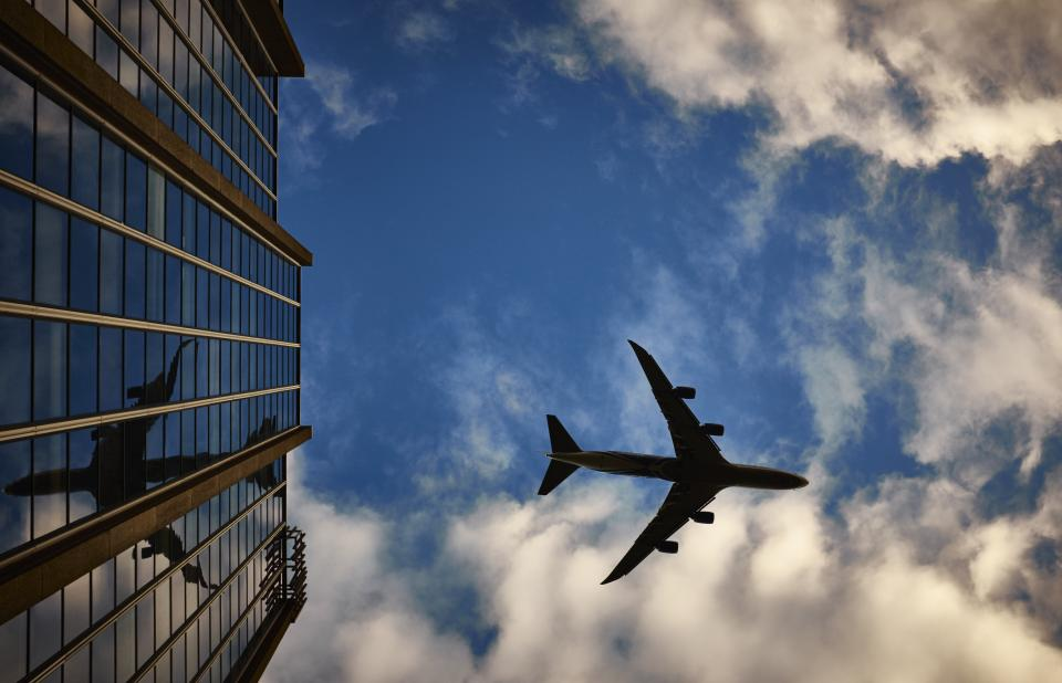 airplane, travel, transportation, trip, blue, sky, clouds, shadow, building, high rise, windows, reflection, city, urban