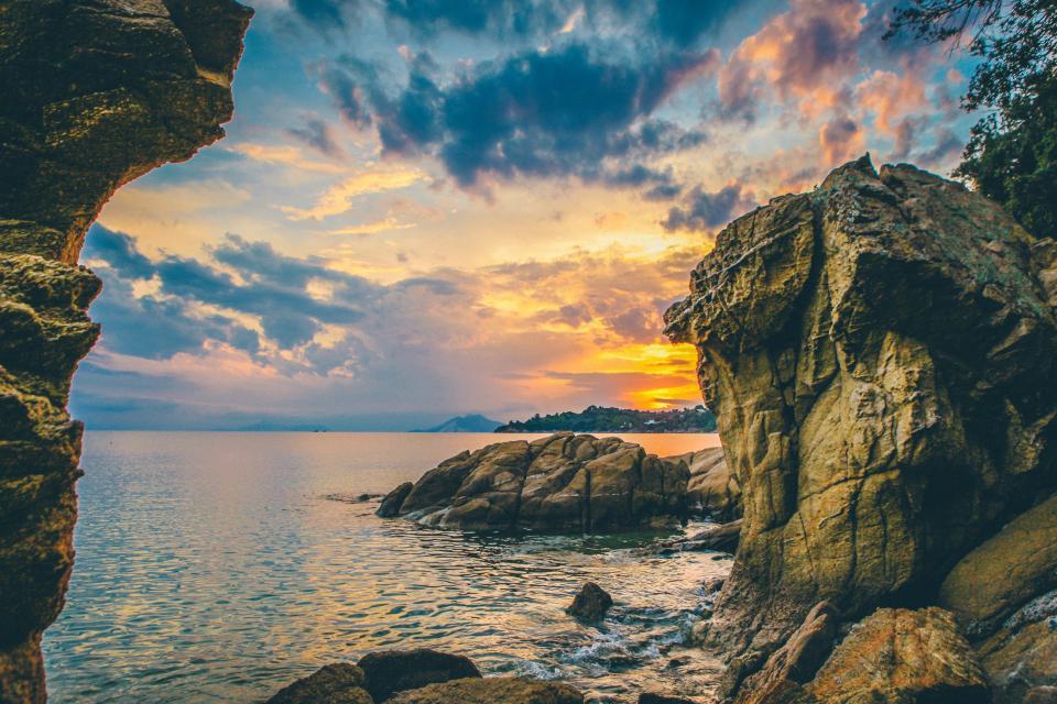 beach, shore, coast, ocean, sea, horizon, sunset, dusk, sky, clouds, rocks, cliffs, boulders, landscape, nature