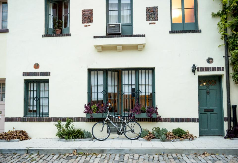 bike, bicycle, building, windows, shutters, sidewalk, street, road, cobblestone, city, urban
