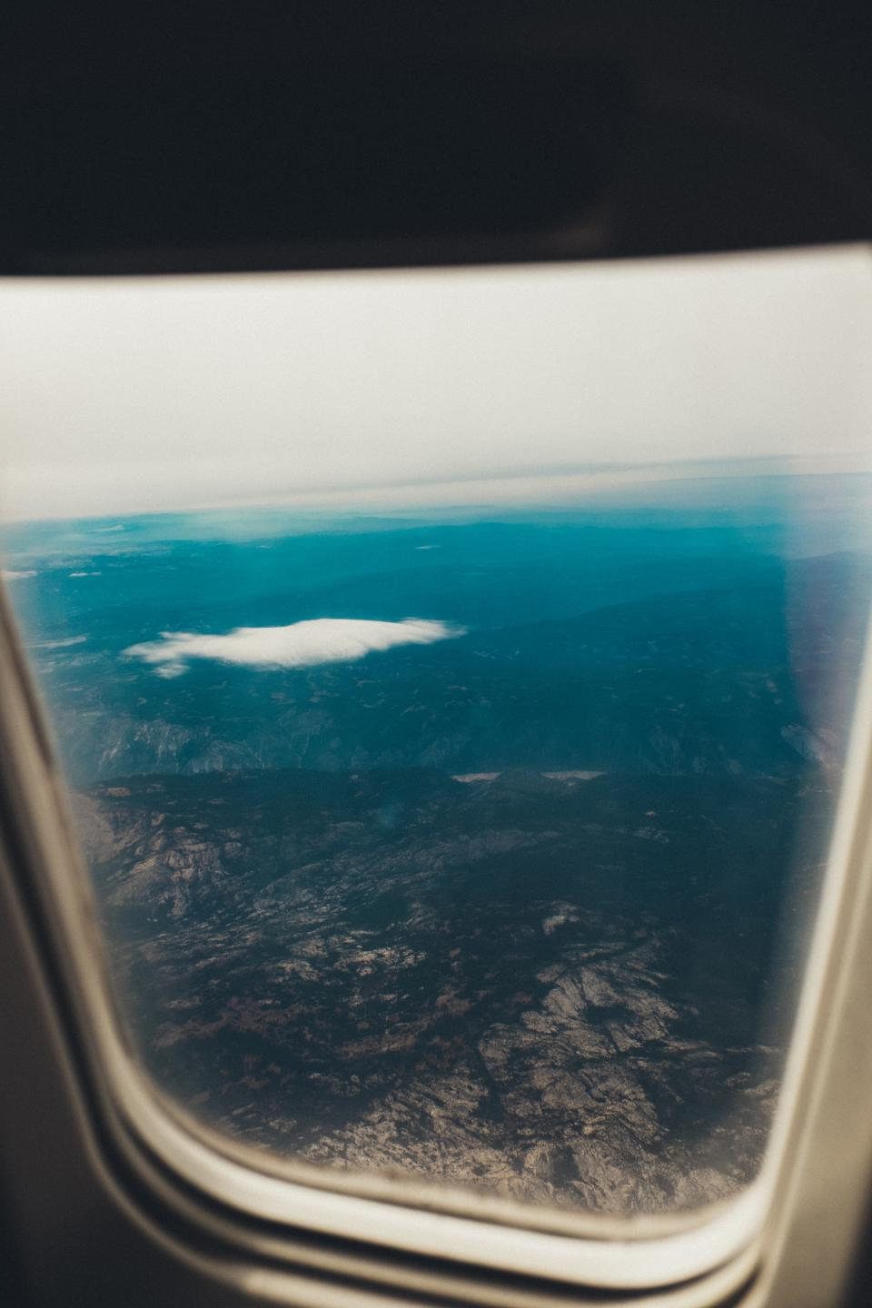 airplane, window, flying, flight, travel, transportation, trip, aerial, view, mountains, sky