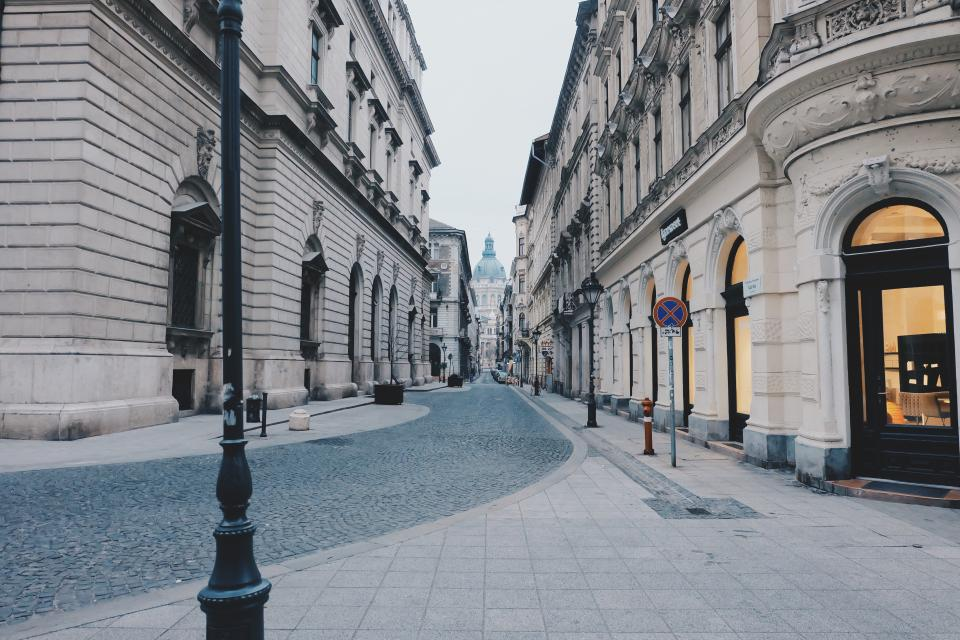 cobblestone, street, sidewalk, lamp posts, signs, buildings, city, architecture