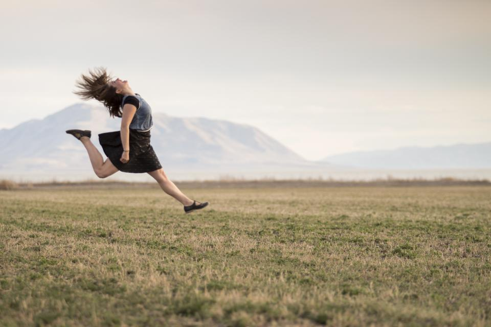 girl, jumping, happy, smiling, field, countryside, rural, landscape, grass, mountains, woman, people, skirt