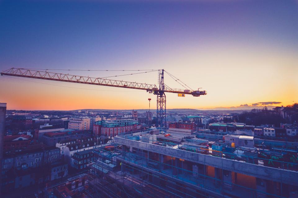 buildings, rooftops, city, architecture, crane, construction, sky, sunset, dusk, evening