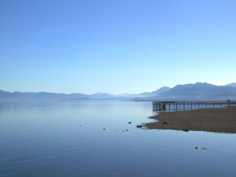 nature, landscape, mountains, summit, peaks, shore, beach, sand, water, still, calm, bridge, dock, blue