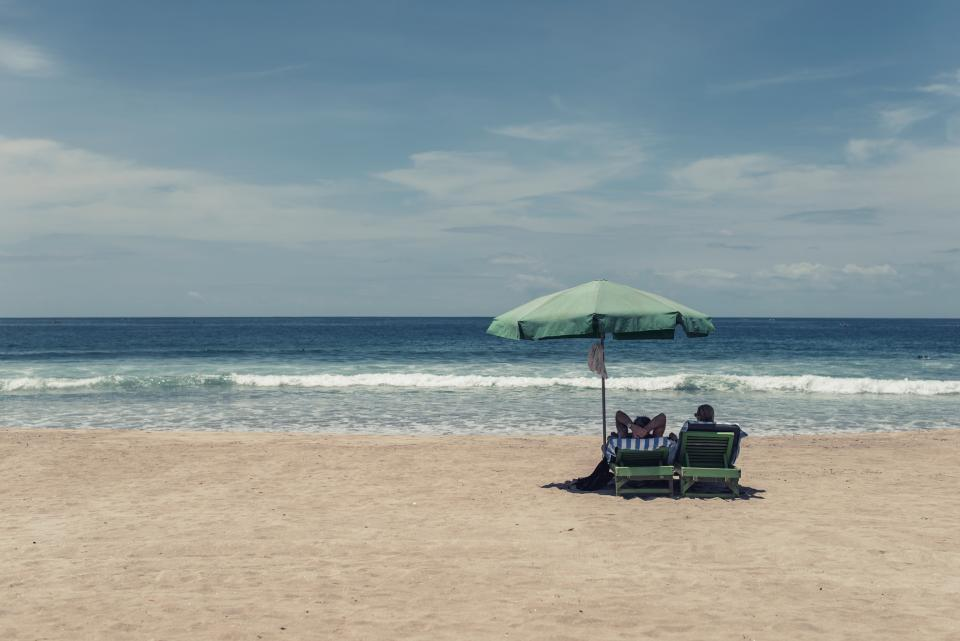 beach, sand, shore, ocean, sea, waves, lounge chairs, umbrella, people, vacation, travel, trip, blue, sky, tropical