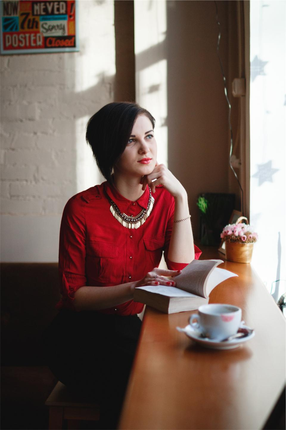 book, reading, girl, woman, pretty, beautiful, people, fashion, cafe, coffee, cup, red, shirt, makeup, thinking, looking