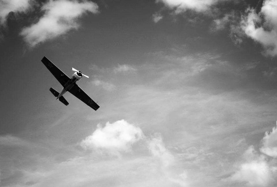 airplane, flying, sky, clouds, travel, transportation, black and white