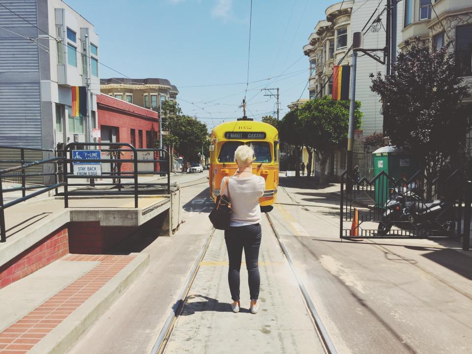 street car, tram, city, urban, girl, woman, people, sunny, street, road