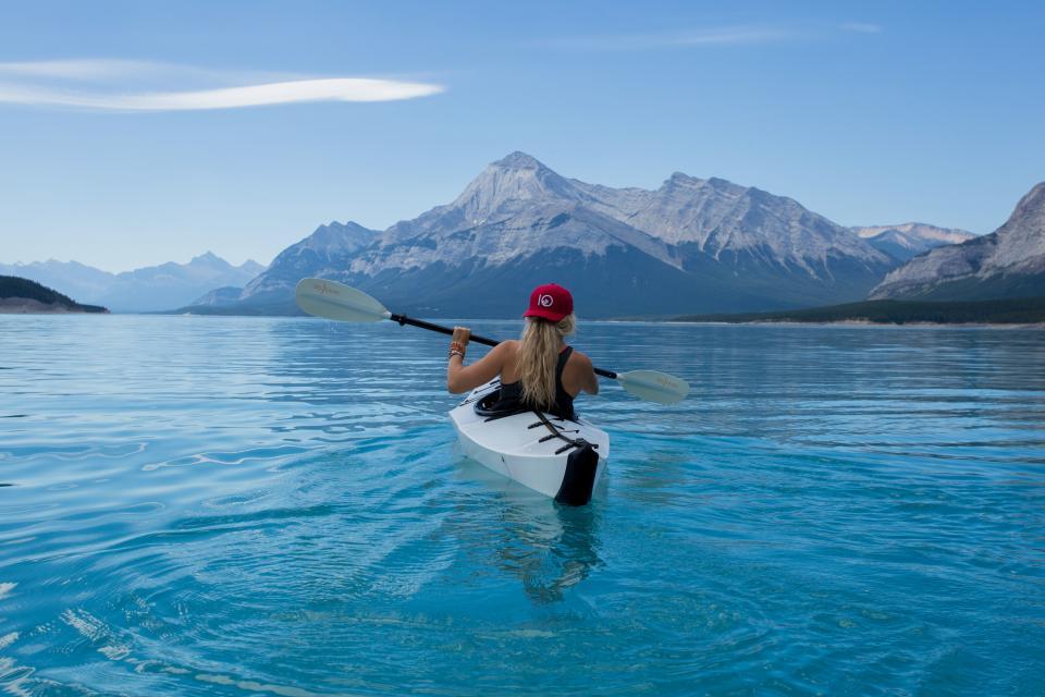 woman, girl, lady, people, back, snapback, cap, kayak, paddle, nature, landscape, mountains, peaks, summit, sea, ocean, water, ripples, sky, clouds, horizon, blue