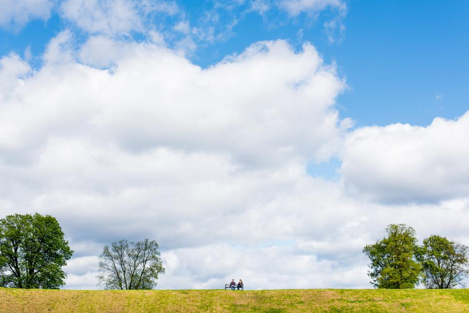 park, bench, couple, people, grass, trees, nature, outdoors, blue, sky, clouds, landscape