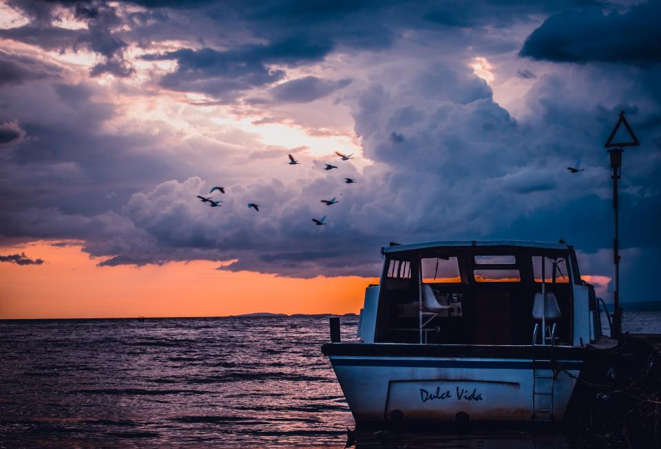 boat, ocean, sea, sunset, dusk, clouds, cloudy, birds, sky, dolce vida, dock