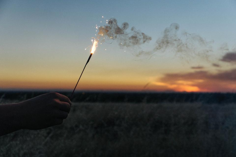 sparkler, flare, smoke, sunset, dusk, field, landscape, nature, hands, shadow, sky, clouds