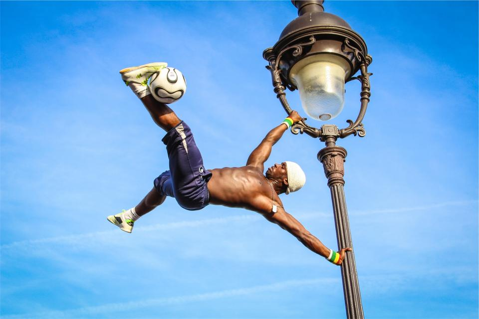fitness, athlete, soccer, ball, shoes, shorts, lamp post, blue, sky, guy, man, muscles, african american