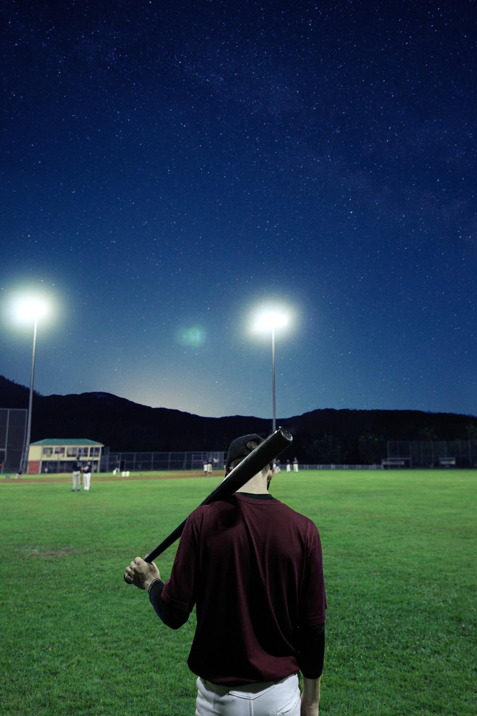 people, space, night, stars, man, alone, solo, dark, baseball, bat, oval, field, green, sad, thinking, reflection, sport, game