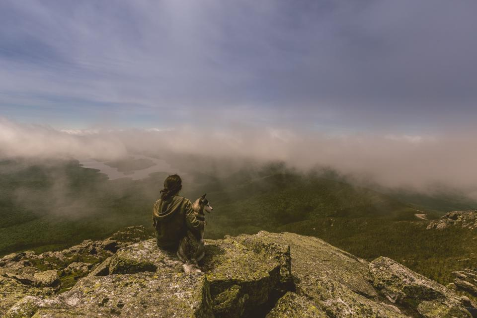 girl, woman, dog, animals, people, rocks, mountains, cliff, hills, landscape, nature, clouds, sky, adventure, fields, grass