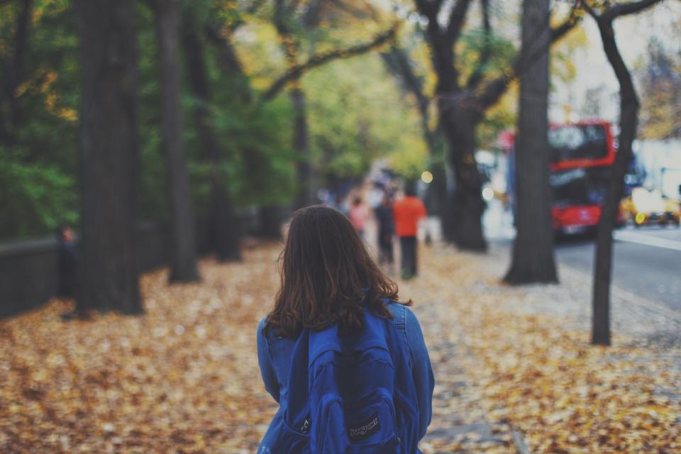 girl, woman, walking, pedestrian, city, urban, lifestyle, sidewalk, leaves, fall, autumn