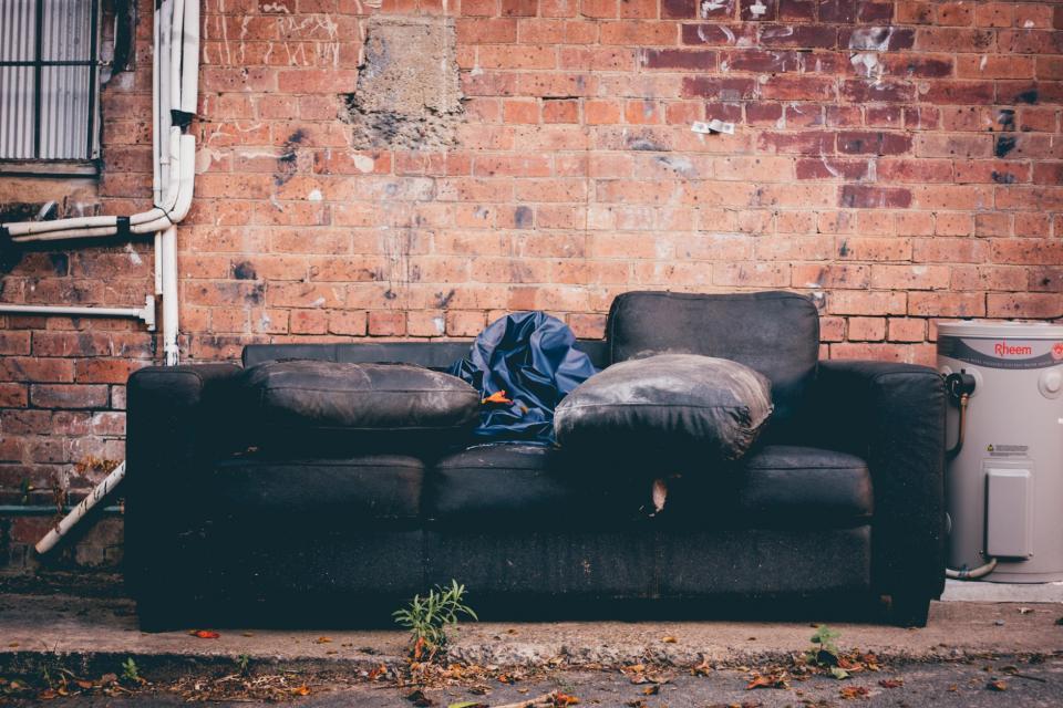 couch, sofa, trash, garbage, bricks, wall, alley, street, city, urban, lifestyle