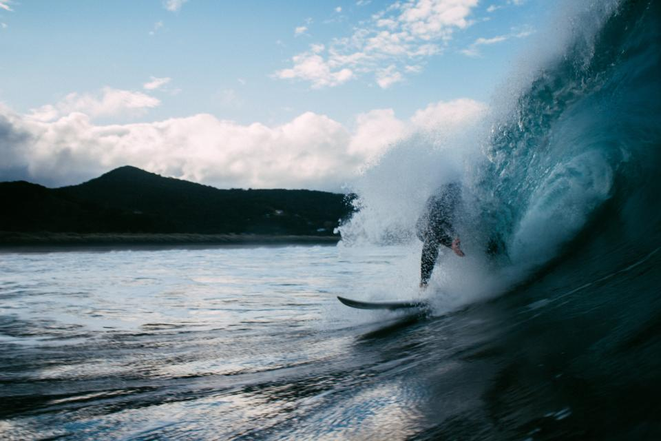 people, guy, surfing, sport, board, wave, sea, water, dark, mountain, sky, clouds, nature