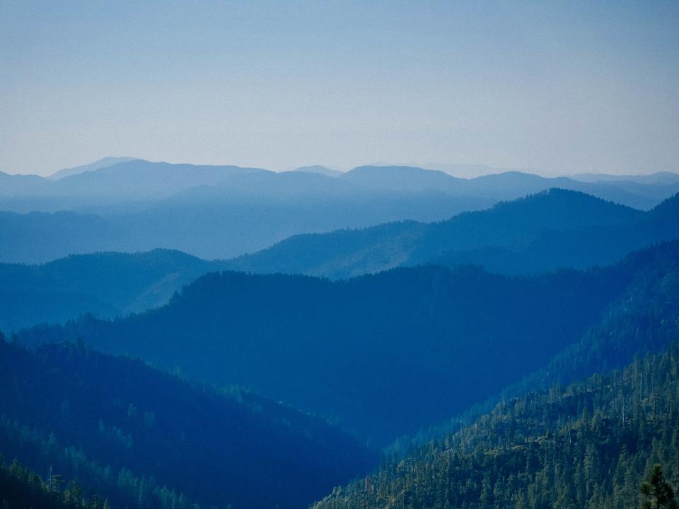 mountains, valleys, peaks, hills, trees, forest, woods, outdoors, landscape, nature, adventure, hiking, trekking, sky, blue