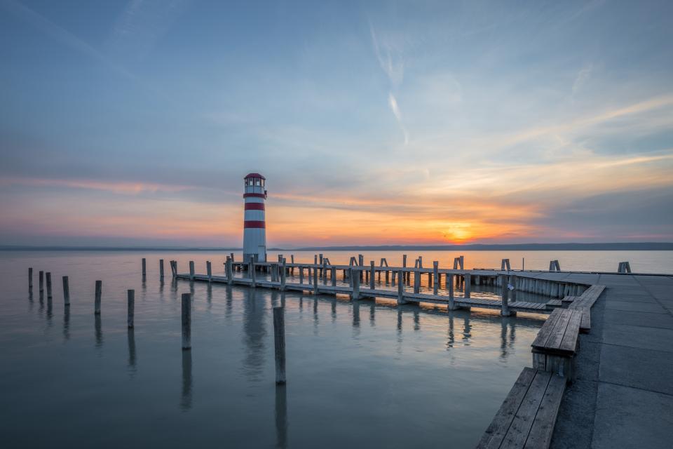 pier, dock, ocean, sea, water, sunset, dusk, lighthouse, sky, clouds, nature, landscape