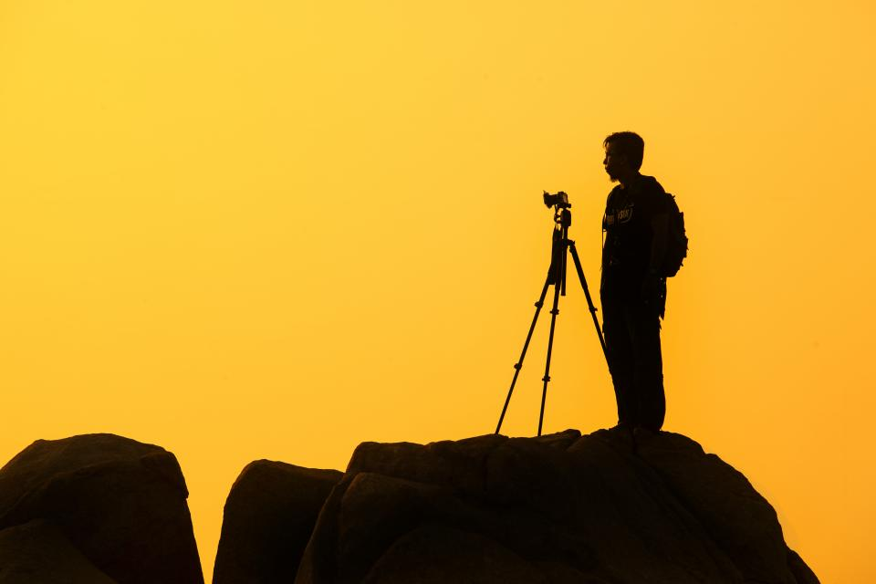 yellow, sunset, dusk, shadow, silhouette, photographer, camera, guy, man, people, rocks