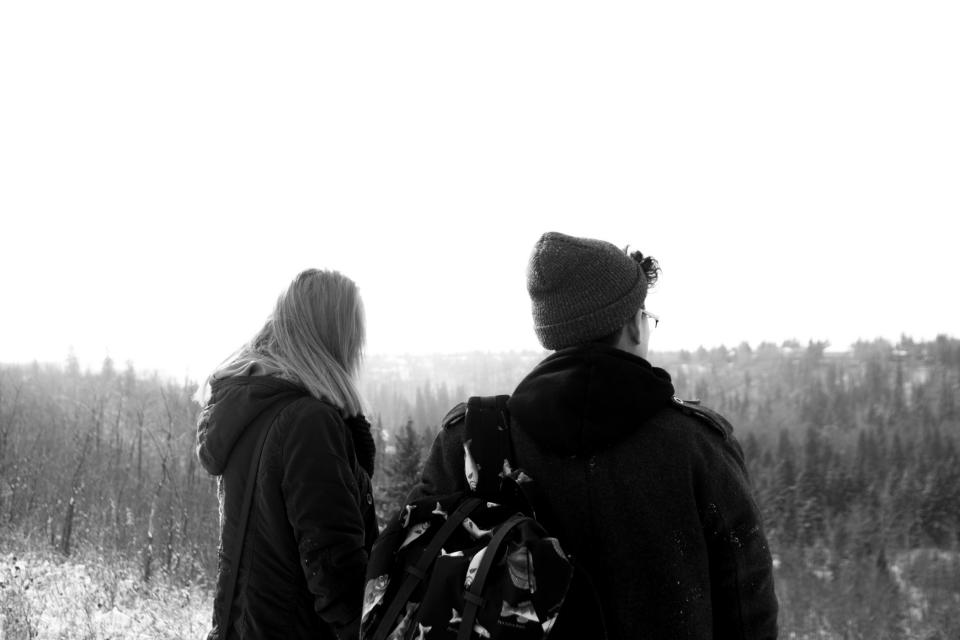 guy, girl, people, outdoors, winter, cold, hat, toque, jacket, backpack, trees, black and white