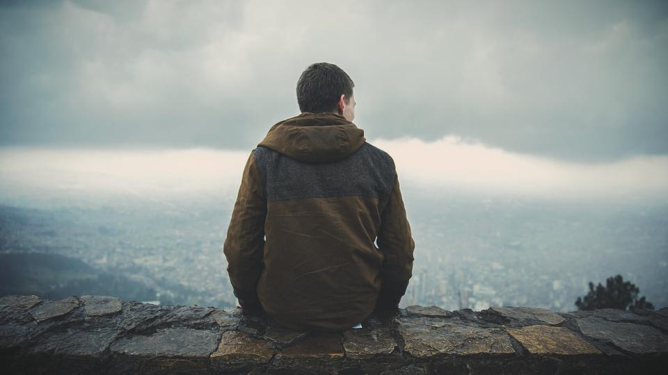 guy, looking, sitting, ledge, city, town, mountains, valleys, hills, clouds, view, people, cloudy