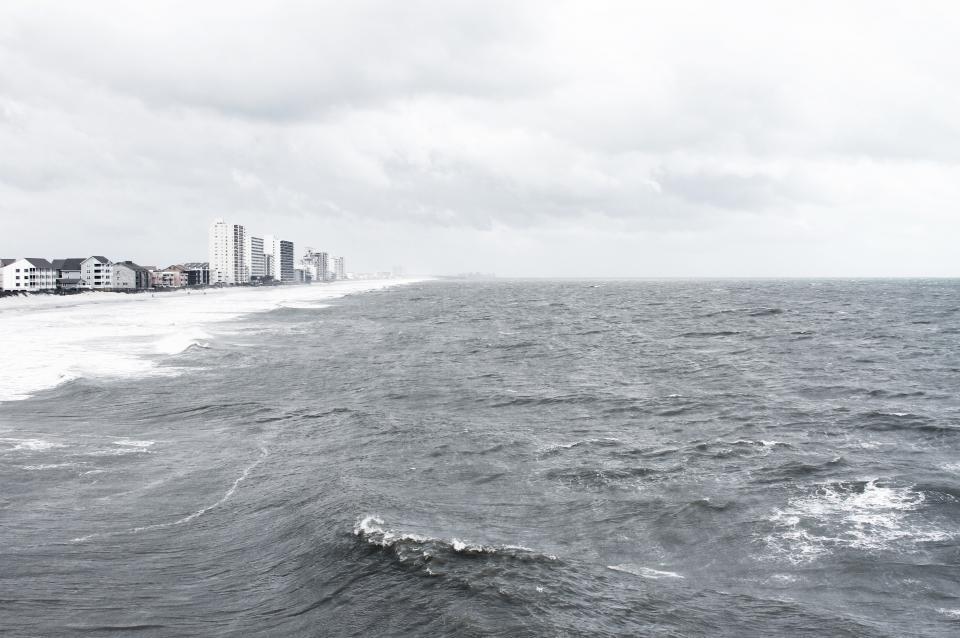 beach, sand, shore, ocean, sea, waves, water, sky, clouds, cloudy, landscape, nature, buildings, high rises