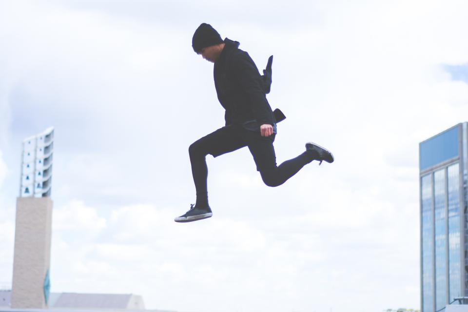 guy, jumping, air, buildings, city, lifestyle, hat, toque, beanie, black, clothes, clouds