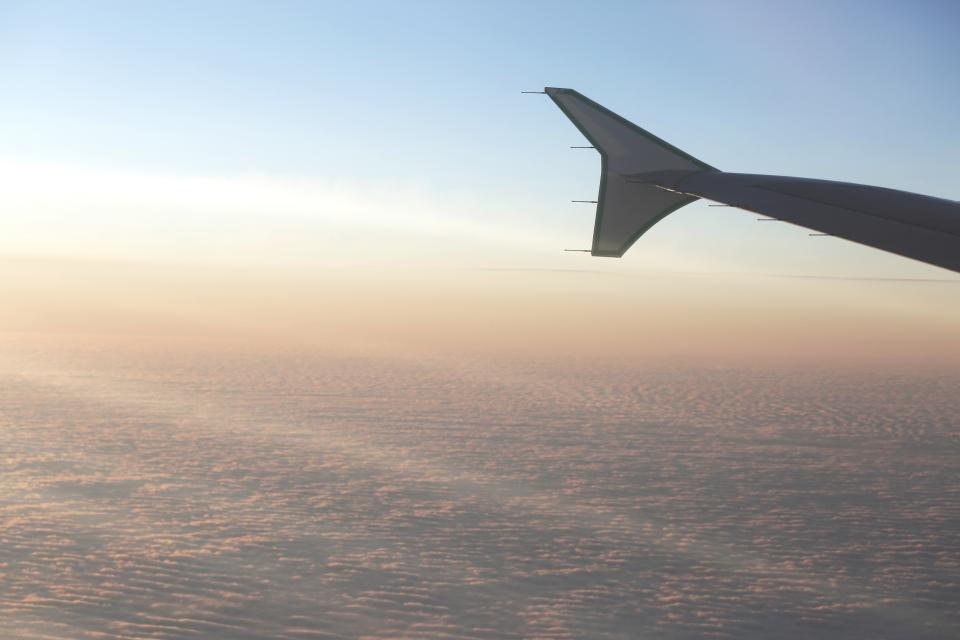 airplane, wing, flying, travel, vacation, trip, transportation, aerial, view, above the clouds, sky, sunshine