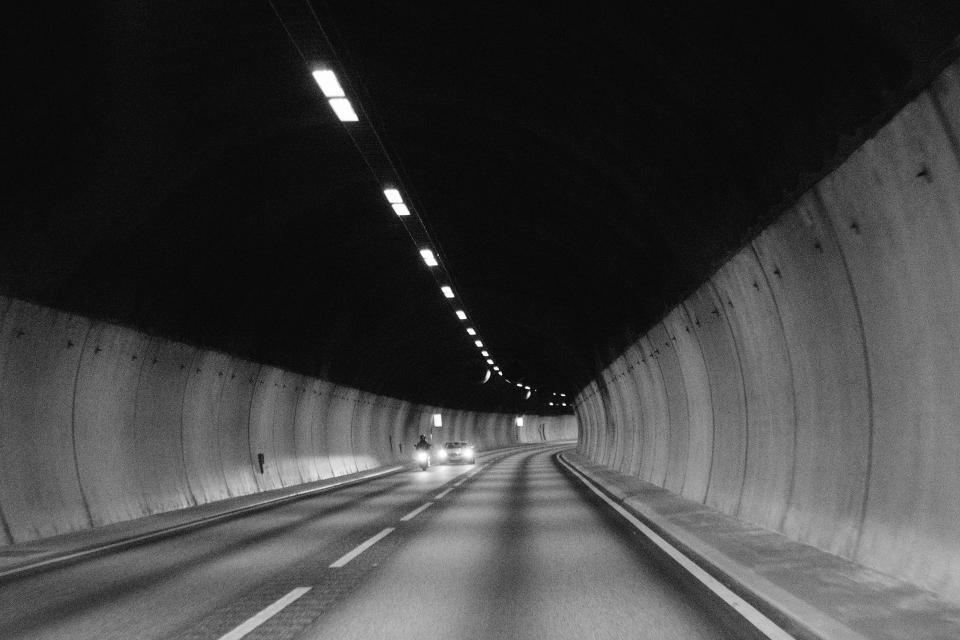 tunnel, road, pavement, cars, motorbike, motorcycle, lights, black and white, automotive