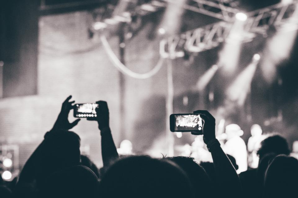 concert, stage, show, entertainment, lights, smoke, band, music, musicians, crowd, people, spectators, cameras, pictures, black and white