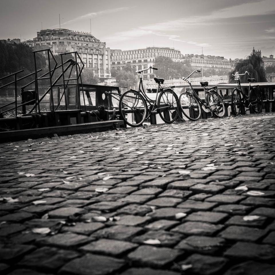 cobblestone, bikes, bicycles, city, town, black and white, architecture