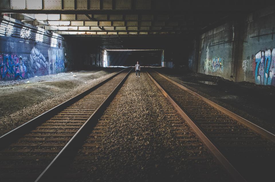 train tracks, railroad, railway, graffiti, underground, urban, guy, people