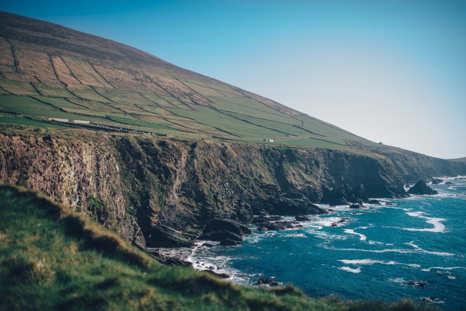 ocean, sea, coast, waves, water, cliffs, mountains, hills, fields, grass, landscape, nature, blue, sky, sunshine, summer, outdoors, travel, vacation